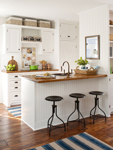 warm wood tones in a white kitchen thumb