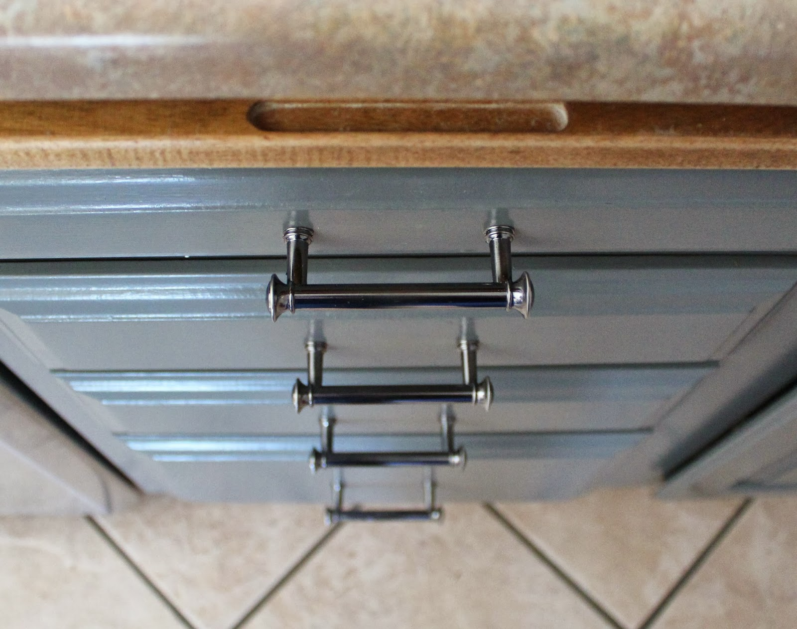 Remodelaholic Grey And White Kitchen Makeover - Hardware for grey cabinets