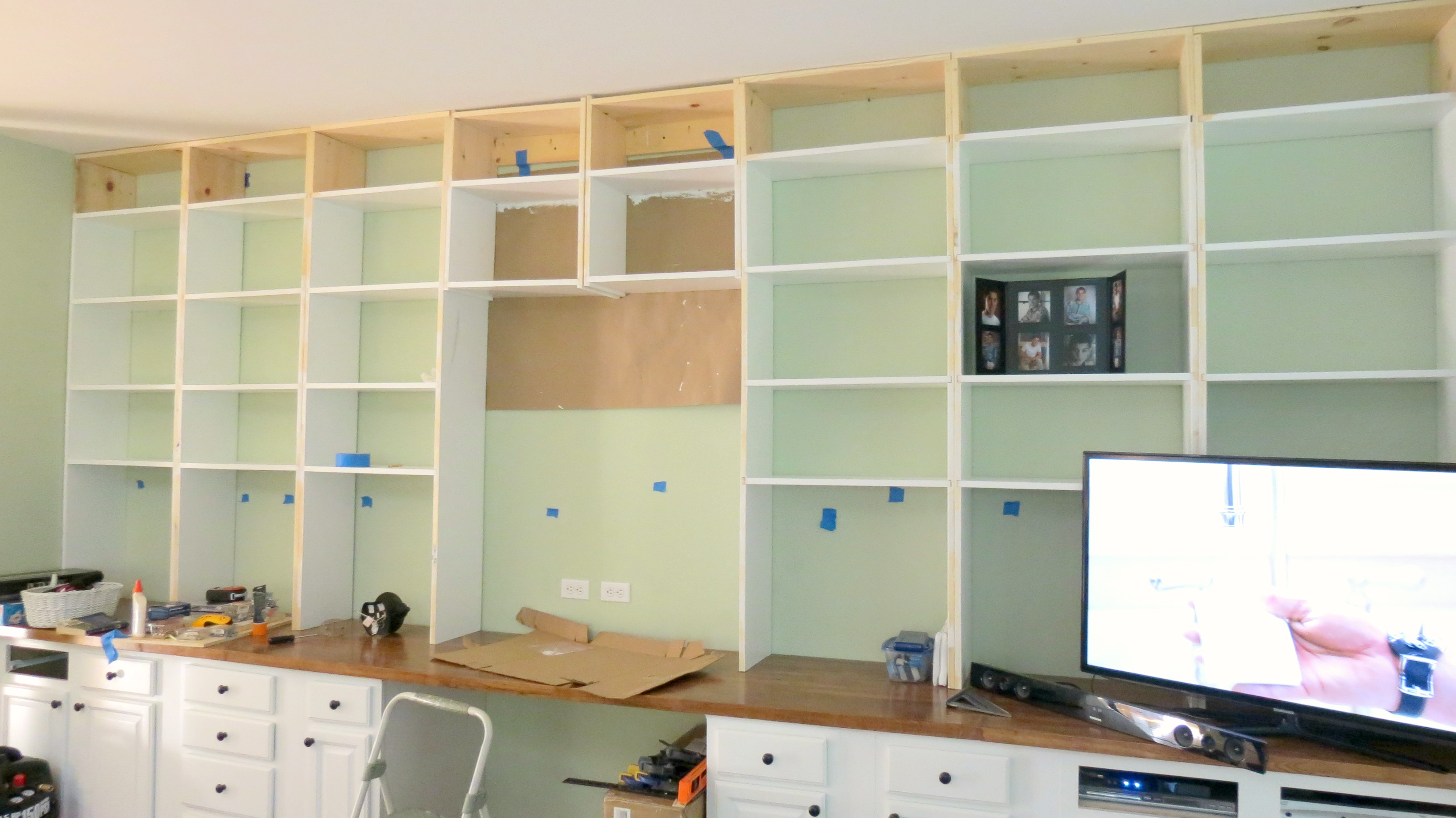 Remodelaholic  Build A WalltoWall BuiltIn Desk and Bookcase