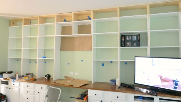 install wall-to-wall built-in bookcases over a desk, Home Is Where My Heart Is featured on Remodelaholic