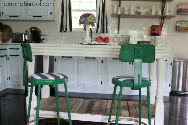 refinished green barstools at a DIY reclaimed wood kitchen island, Rain On A Tin Roof featured on Remodelaholic