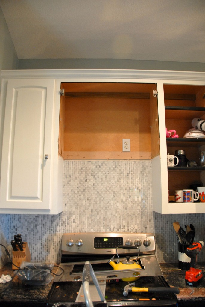 Remodelaholic how to diy a custom range hood for under 50 remove cabinet for custom range hood the rozy home featured on remodelaholic solutioingenieria Images