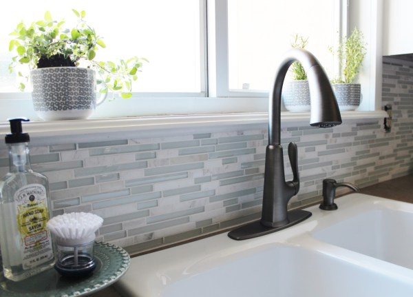 smudge-resistant pasadena faucet in slate for a grey and white kitchen, House For Five featured on Remodelaholic