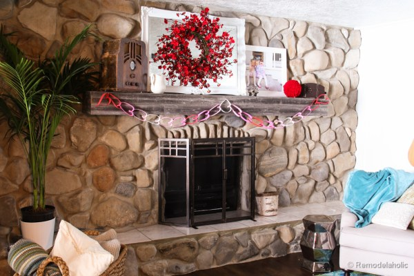 Valentines mantel and TV in fireplace (1 of 8)