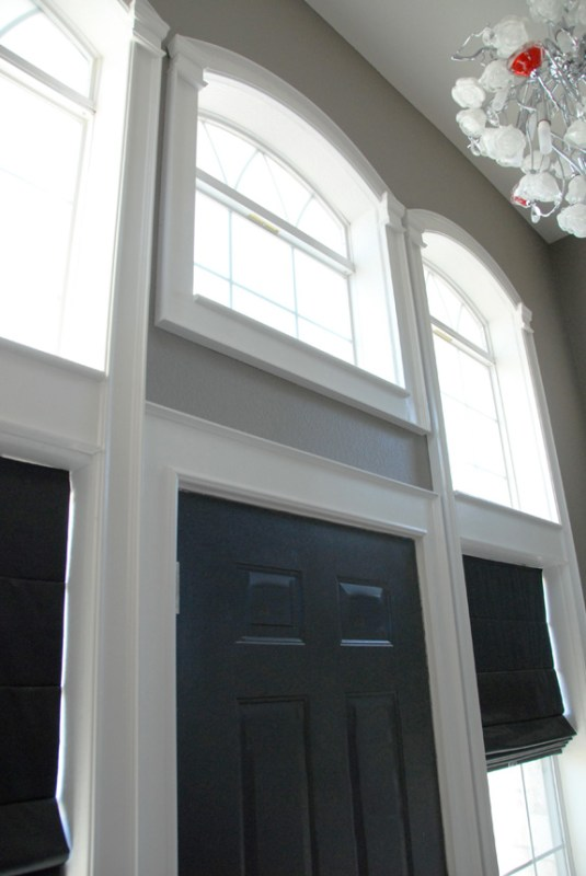 finished windows with arched trim, The Rozy Home featured on Remodelaholic