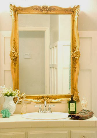 gold curvy mirror bathroom makeover, Vintage Romance featured on Remodelaholic