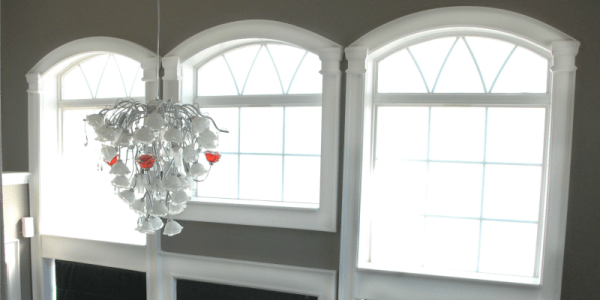 molding trim on arched entry windows, The Rozy Home featured on Remodelaholic