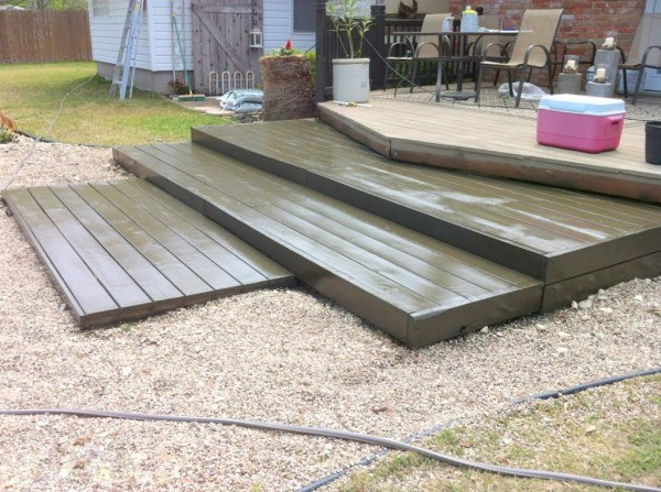 stained tiered pallet wood deck, The Second Wind of Texas featured on Remodelaholic