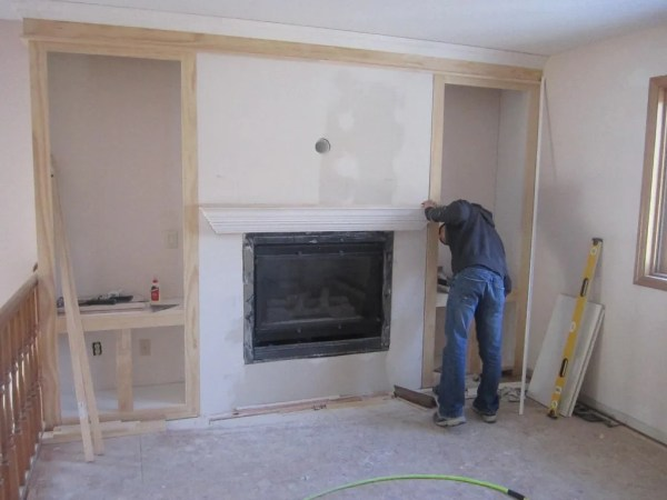 framing in the fireplace built-in shelves, construction2style on Remodelaholic