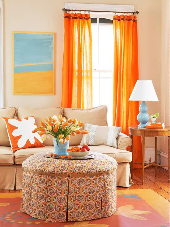 orange curtains and modern blue accents