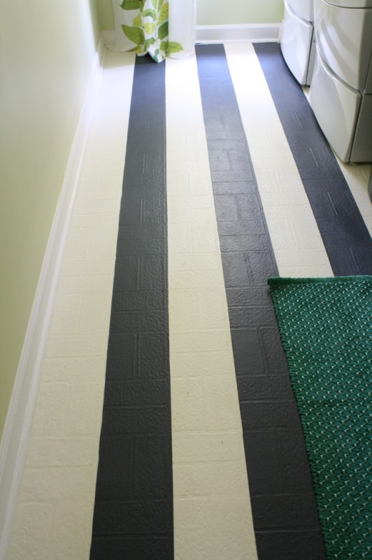 Painted Laundry Room Floor by Designer Trapped in a Lawyer's Body featured on Remodelaholic.com