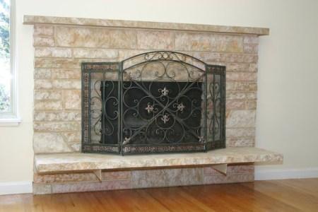 restoring a painted stone fireplace, featured on Remodelaholic