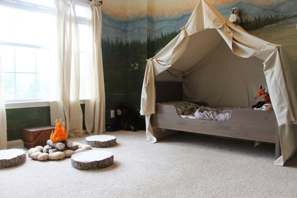 woodland themed kids room with camping tent bed and play campfire, The Ragged Wren on Remodelaholic