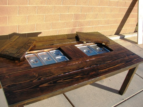 Patio table with built in stream trays featured on @Remodelaholic