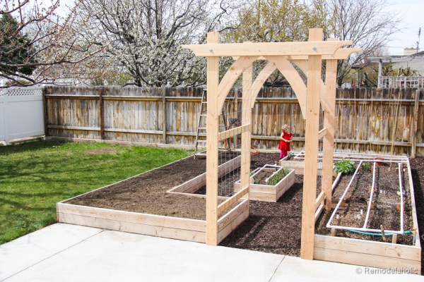 Add a raised garden bed with trellis and arbor that you can build yourself featured on Remodelaholic.com