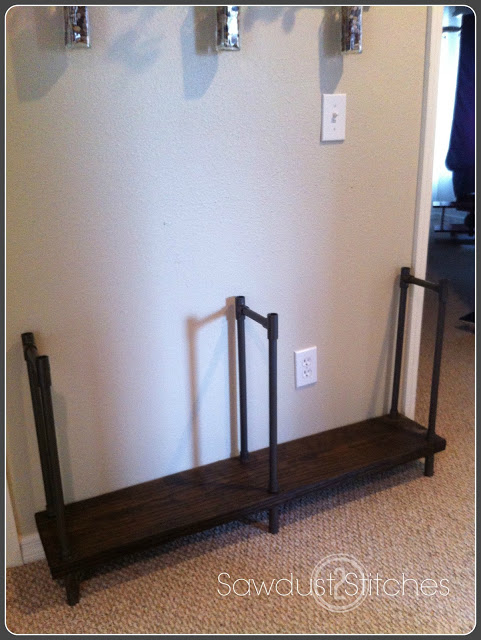 Using PVC instead of metal pipe makes industrial shelving easier and cheaper. Learn how at Remodelaholic.com