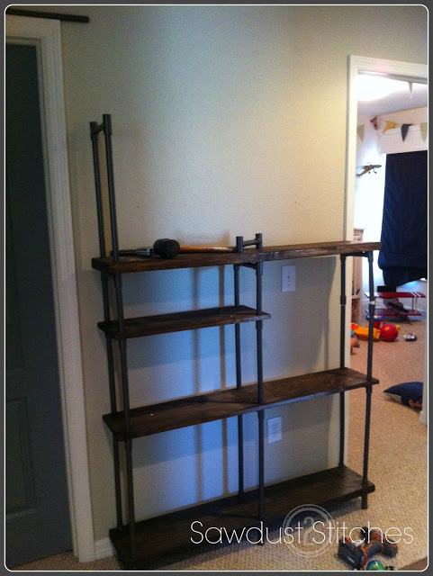 Make industrial-style shelving on a budget! #Remodelaholic