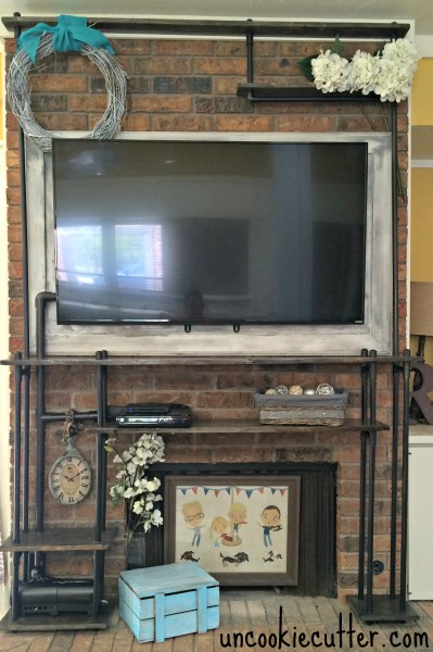 pvc industrial pipe shelves to hide TV cords - Uncookie Cutter
