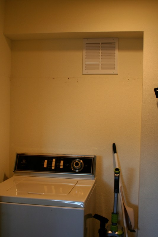 remove laundry room shelf for stacking washer and dryer, Love Melinda on Remodelaholic