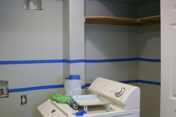 stencil painted accent border in small laundry room, Love Melinda on Remodelaholic