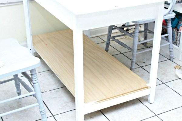Bottom shelf on desk
