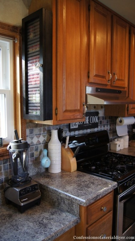 Save space with a DIY spice cabinet on the side of the kitchen cabinet | Confessions of a Serial DIYer on Remodelaholic.com