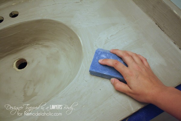 MUST PIN! Learn how to transform a cultured marble counter top and sink with concrete on Remodelaholic.com!