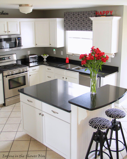 L shaped kitchen layout in black and white via Remodelaholic