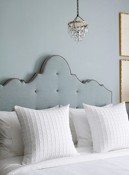 blue linen ornate camelback crown headboard with contrast blue trim and tufting buttons via DecorPad