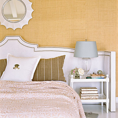 extra wide keystone headboard with arms and nailhead trim via Coastal Living