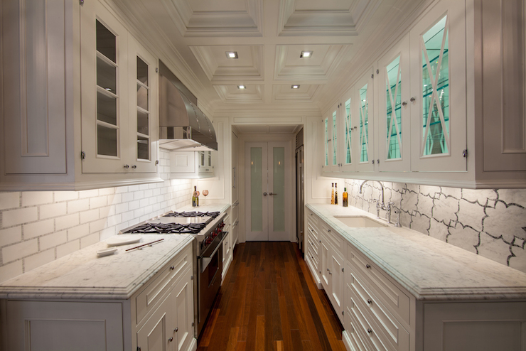 galley kitchen with blue wallpaper and undermount sink via DecorPad