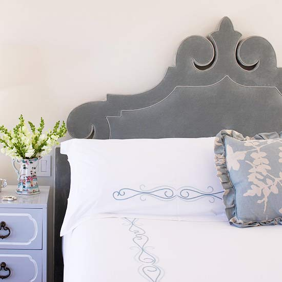gray velvet carved ornate headboard via BHG