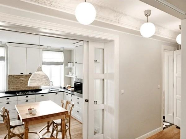horseshoe kitchen layout with glass pocket doors via DecorPad