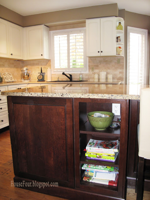 kitchen island with bookshelves via Remodelaholic