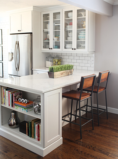 peninsula kitchen layout with built-in bookshelf via 7th House on the Left