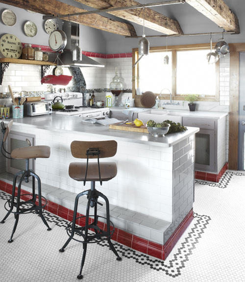 peninsula kitchen layout with open ceiling beams and tile via Country Living