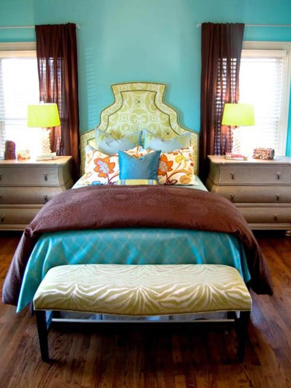 tall custom arched keystone headboard in green with contrast trim via HGTV