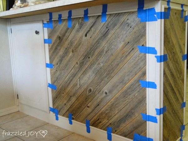adding trim to reclaimed wood plank kitchen island, Frazzled Joy on Remodelaholic