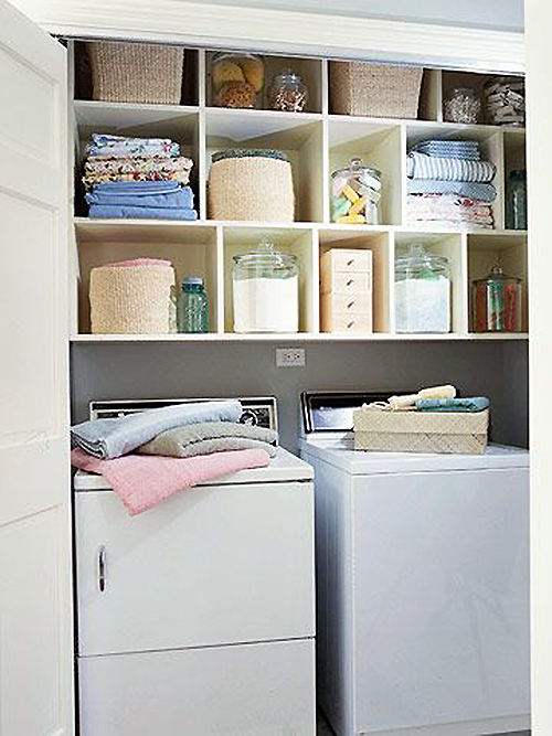 Closet Laundry with pretty storage featured on remodelaholic.com