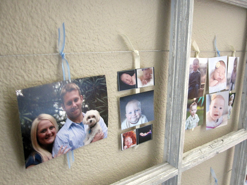 Design Build Love - use ribbon and wire to hang photos and cards in an old paned window - via Remodelaholic