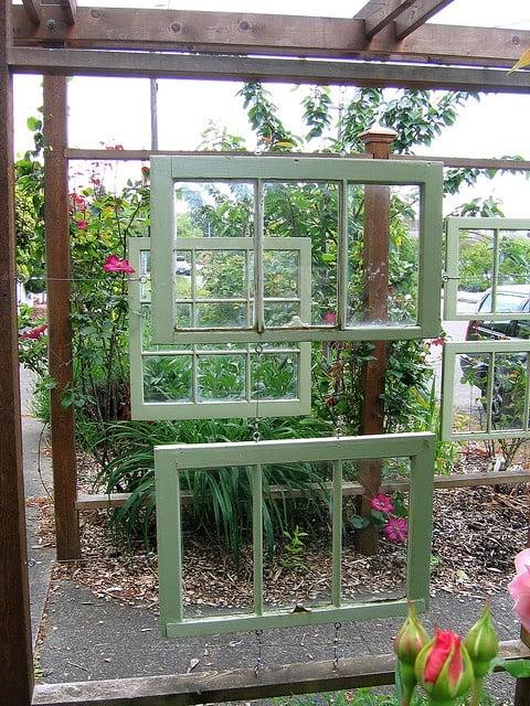 Flickr user lifebegreen - windowed arbor in garden path - via Remodelaholic