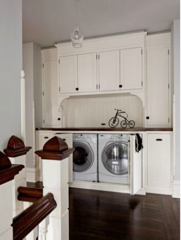 Hallway Laundry Space built in hidden laundry featured on Remodelaholic.com