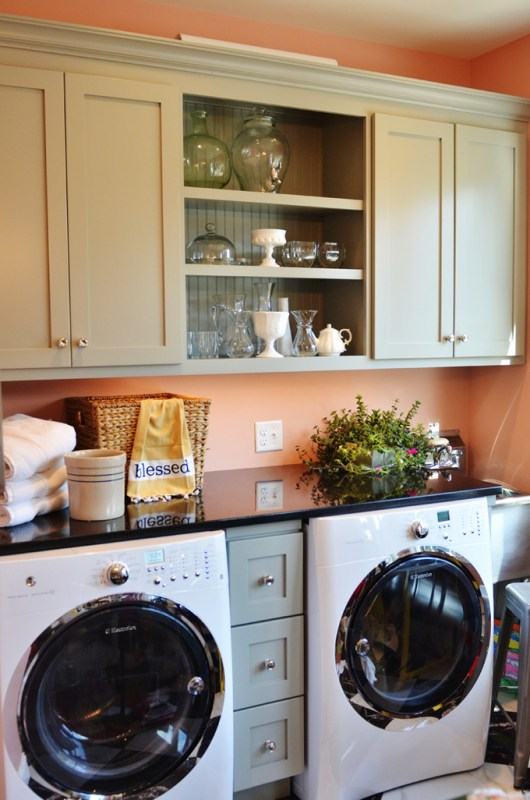 Simple laundry room with colored cabinets2