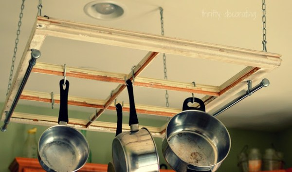 The Frugal Girls - old window into a kitchen pot rack - via Remodelaholic