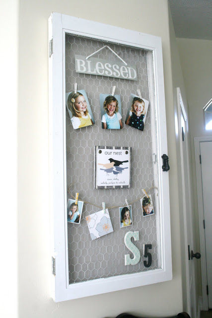 The House of Smiths - old window into hinged chicken wire photo holder - via Remodelaholic