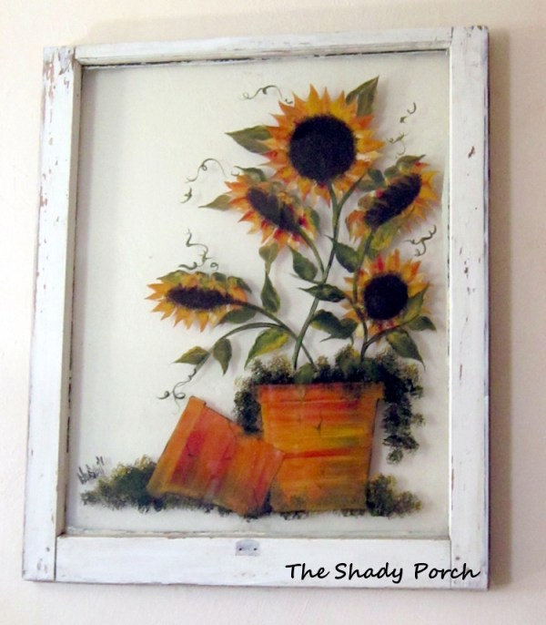 The Shady Porch - paint on an old window like a canvas via Remodelaholic