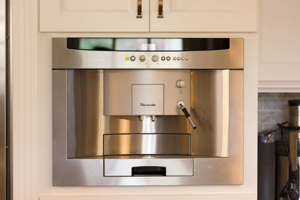 built-in espresso machine in a white kitchen renovation on Remodelaholic
