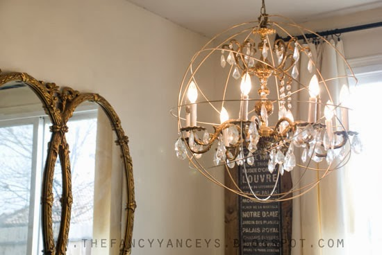 Remodelaholic upcycle a vanity light strip to a hanging pendant light knockoff crystal orb chandelier how to make a restoration hardware crystal orb chandelier vintage romance style featured on remodelaholic aloadofball Image collections