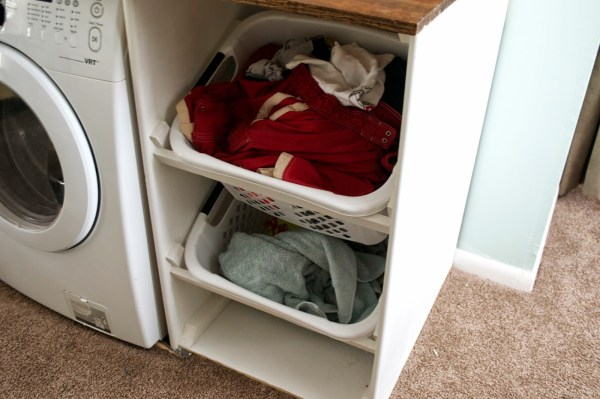 laundry baskets in washer and dryer unit, Seesaws and Sawhorses on Remodelaholic