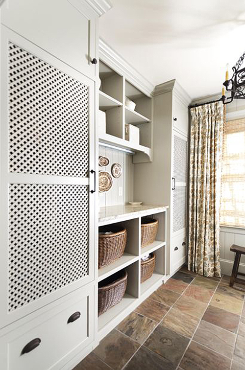 laundry room with hidden machines and possibly vented doors featured on Remodelahoilc.com